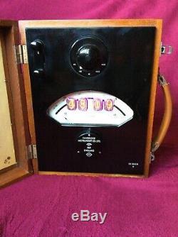 4 Tube Nixie Clock Within Recycled Vintage Volt Meter
