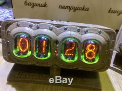 Nixie Tube Clock in a plastic case in the steampunk style on gas lamps