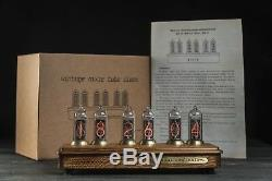 Past Indicator Nixie tube clock in oak and brass case